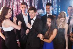 Friends dancing at nightclub Kuvituskuvat