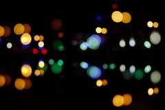 Night traffic lights of the big city with reflection. Artistic style. Defocused Stock Photos