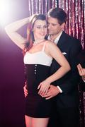 Couple dancing at nightclub Kuvituskuvat