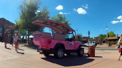Pink Jeep Touring Car Parked In Downtown Sedona Arizona Stock Footage
