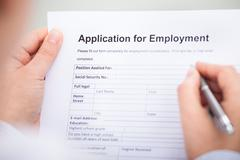 Stock Photo of businessperson with employment form