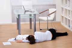 businesswoman fainted on floor - stock photo