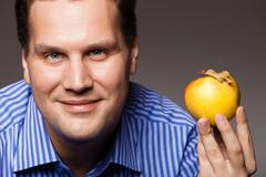 Diet nutrition. happy man holding apple fruit Stock Photos
