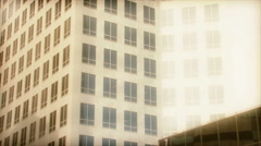 Overexposed tilt up of tall building Stock Footage