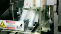 Tape producing toothpaste - stock footage