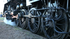 Steam locomotive rolling on the rails Stock Footage
