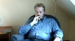 Fat guy in deep thought Stock Footage