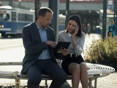 Business people with tablet and cellphone on bench in the city NTSC - stock footage