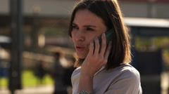 Young pretty busineswoman talking on cellphone in the city HD Stock Footage
