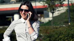 Young attractive businesswoman talking on cellphone in the city HD Stock Footage