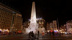 Dutch people and world travelers enjoy walking Dam Square time lapse Stock Footage