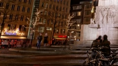 Pan Dutch people and world travelers enjoy walking Dam Square time lapse Stock Footage