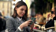 Young businesswoman texting, sending sms on smartphone, sitting in cafe HD - stock footage