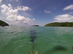 POV Snorkler swimming on his back Stock Footage