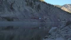 Freight Train Emerging From Tunnel Fraser River Canyon Canada Morning HD Stock Footage