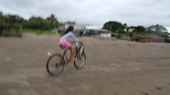 Young Girl Riding Bicycle on the Beach Stock Footage