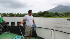 Ferry Boatman Throws a Lead Line with a Rock to Shore - stock footage