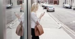Attractive blonde business woman using smartphone commuter in city london Arkistovideo