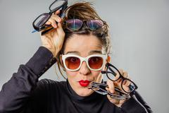 Real girl with various glasses and red lips gesturing - stock photo