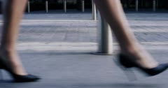 Sexy legs black high heels walking in city urban street - stock footage