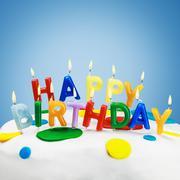 Candles on a birthday cake Stock Photos