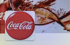 Close-up open company logo of coca-cola on a home computer screen Stock Photos