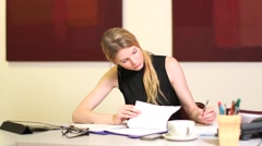 Girl Studies and writes notes Stock Footage