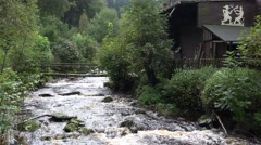 4k Wild river with bridge and old traditional house in low mountain range Harz Stock Footage