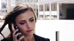 Attractive business woman commuter using smartphone walking in city of london Stock Footage