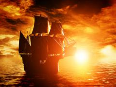 ancient pirate ship sailing on the ocean at sunset. in full sail. - stock illustration