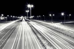 Highway traffic at night. cars lights in motion on the streets. transport, tr Kuvituskuvat