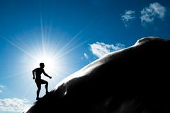 silhouette of a man running up hill to the peak of the mountain. trekking, ac - stock illustration