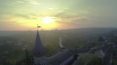 Fortress weather vane in red beams of  sun. Aerial shot, Beautiful landscape Stock Footage