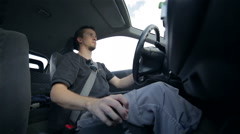 Person driving car and shifting gear wide shot Stock Footage