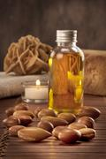 Seeds of argan with light and soap Stock Photos