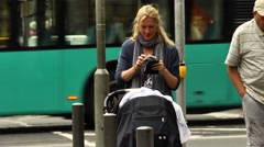 Mum photographing her child in a pram Stock Footage