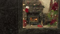 Cosy Indoor Christmas as snow falls outdoors Stock Footage