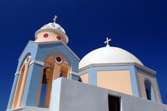 a white church in fira on santorini island, greece. characteristic architectu - stock photo
