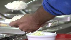 Serving / put rice on dish - self service restaurant Stock Footage