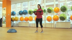 Young woman doing exercise with barbell Stock Footage