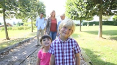 family walking out from grandparents' house - stock footage