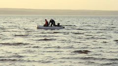 Two mans fishing together in a boat Stock Footage