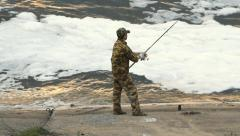 Young man fishing on a lake Stock Footage