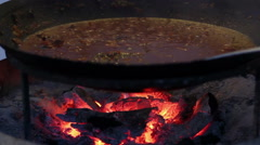 Cooking Food On The Fire In The Cauldron Stock Footage