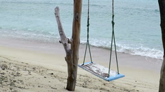 Rustic swing on seashore at Gili Air beach Stock Footage