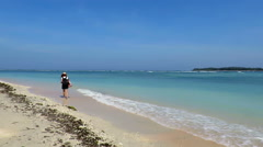 Woman walking by beautiful sea Stock Footage