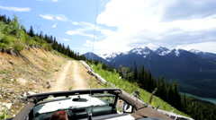 POV land machine vehicle driving Off road journey mountainside 4x4 Canada - stock footage