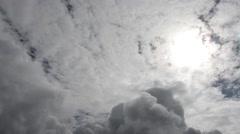 Backlit dense moving clouds Stock Footage