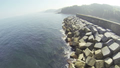 Coast with Wave Breaker Stock Footage