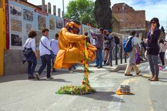 Street performer in clothing monk demonstrates  trick of levitation in rome,  Stock Photos